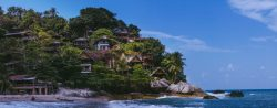 beachfront property, lush greenery, ocean, huts