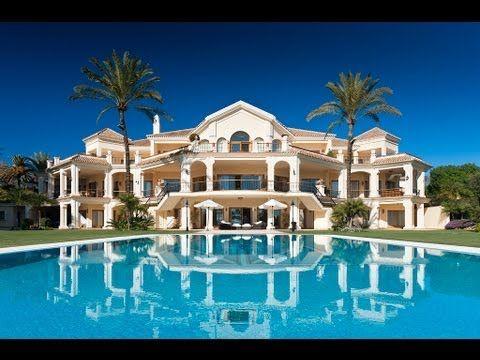 Mansion, pool, palm trees