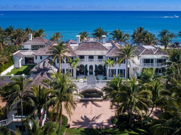 ocean front property, mansion, palm trees