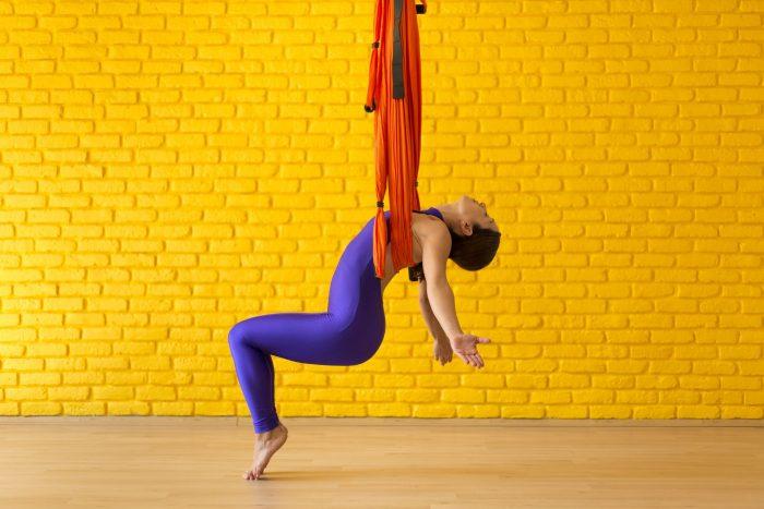 young-woman-doing-antigravity-yoga-royalty-free-image-1594827101